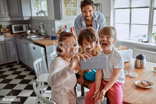 894071774 istock photo Family taking a selfie 903488024