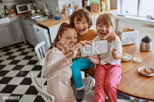 894071774 istock photo Family taking a selfie 903490412