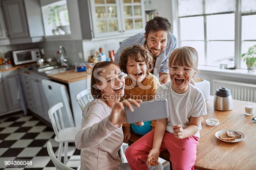 894071774 istock photo Family taking a selfie 904366048