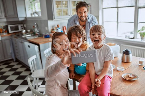 894071774 istock photo Family taking a selfie 904371250