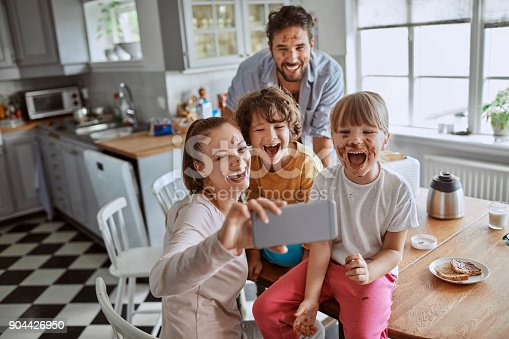 894071774 istock photo Family taking a selfie 904426950