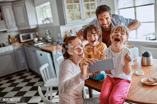 894071774 istock photo Family taking a selfie 905780772