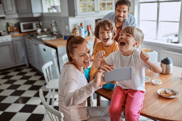 family taking a selfie - eating technology stock pictures, royalty-free photos & images