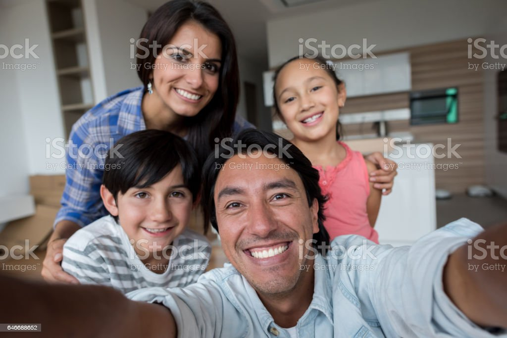 Family taking a selfie while moving home stock photo