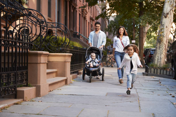 Family taking a walk down the street, close up stock photo