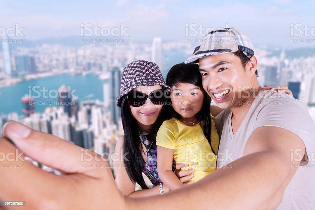Family taking photo in the city royalty-free stock photo