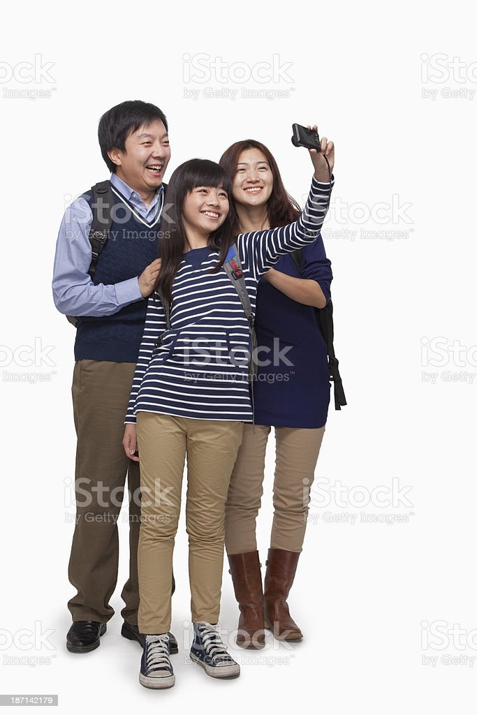 Family taking picture with digital camera stock photo