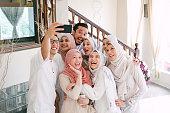 istock Family Taking Selfie Together Celebrating Hari Raya Aidilfitri (Eid al-Fitr) 1146942741