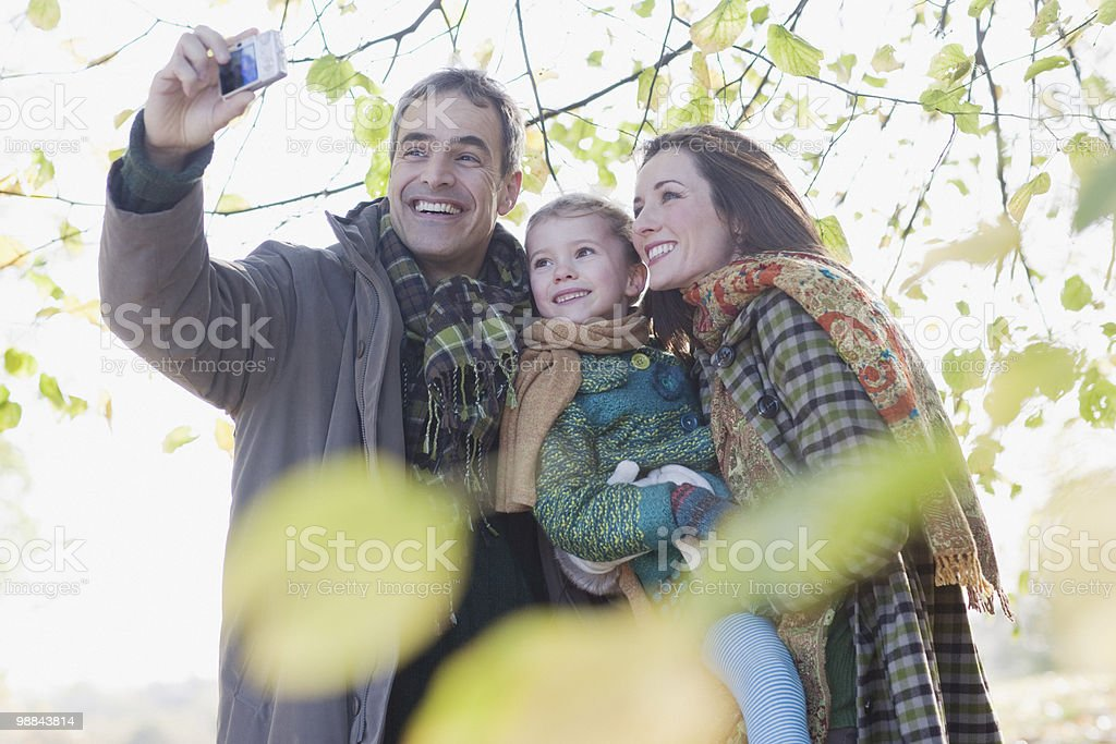 Family taking self-portrait outdoors in autumn 免版稅 stock photo