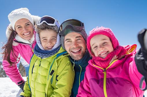 Family taking winter selfie