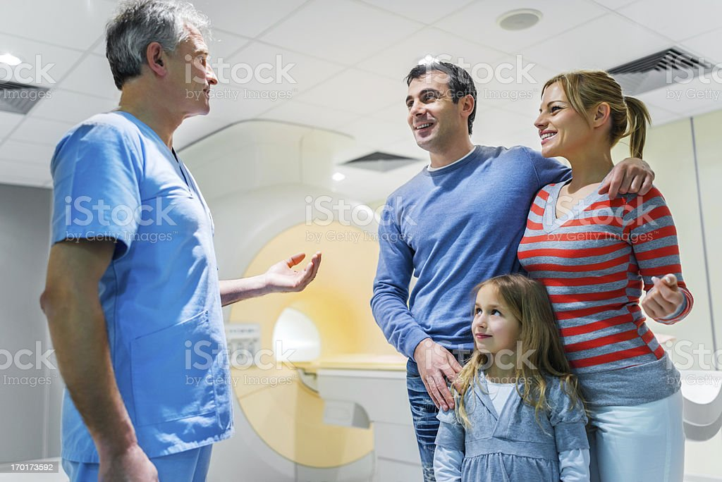 Family talking to a doctor about MRI scan royalty-free stock photo