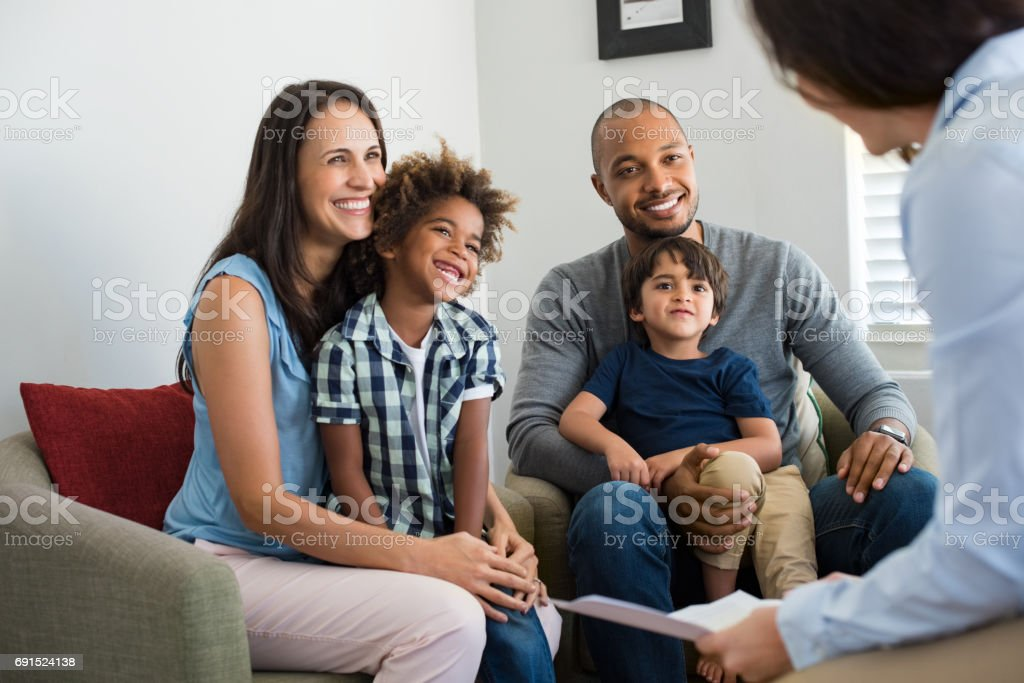 Family talking with counselor stock photo
