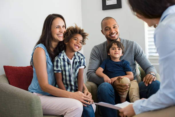 family talking with counselor - stock broker stock photos and pictures