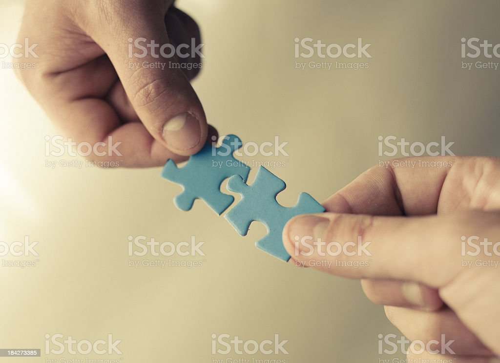 Family teamwork - puzzle connection royalty-free stock photo