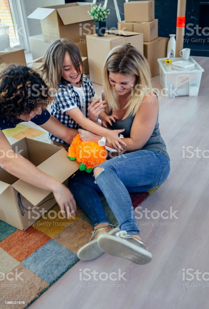 Family tickling the mother stock photo