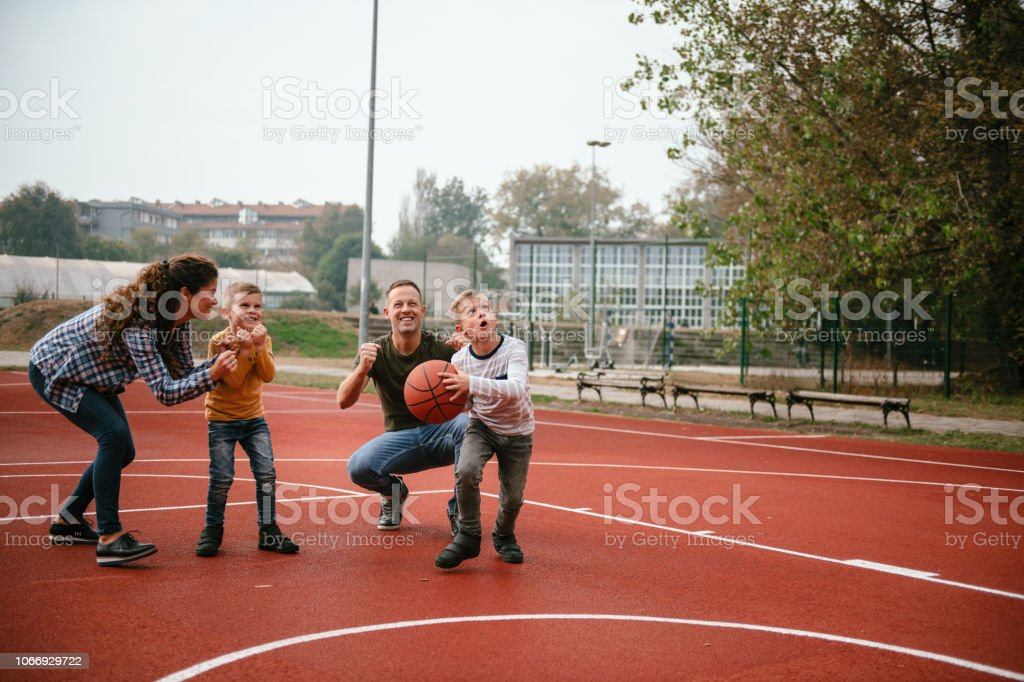 Family time on basketball field. Shallow DOF. Developed from RAW;...