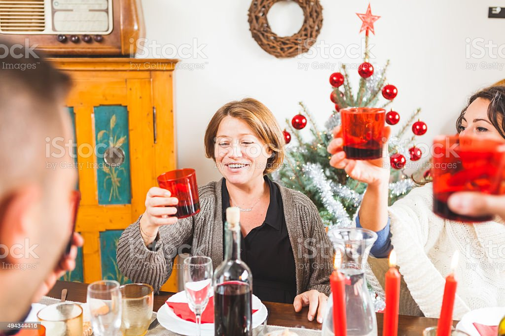 Family Toasting for Christmas Dinner at Home stock photo