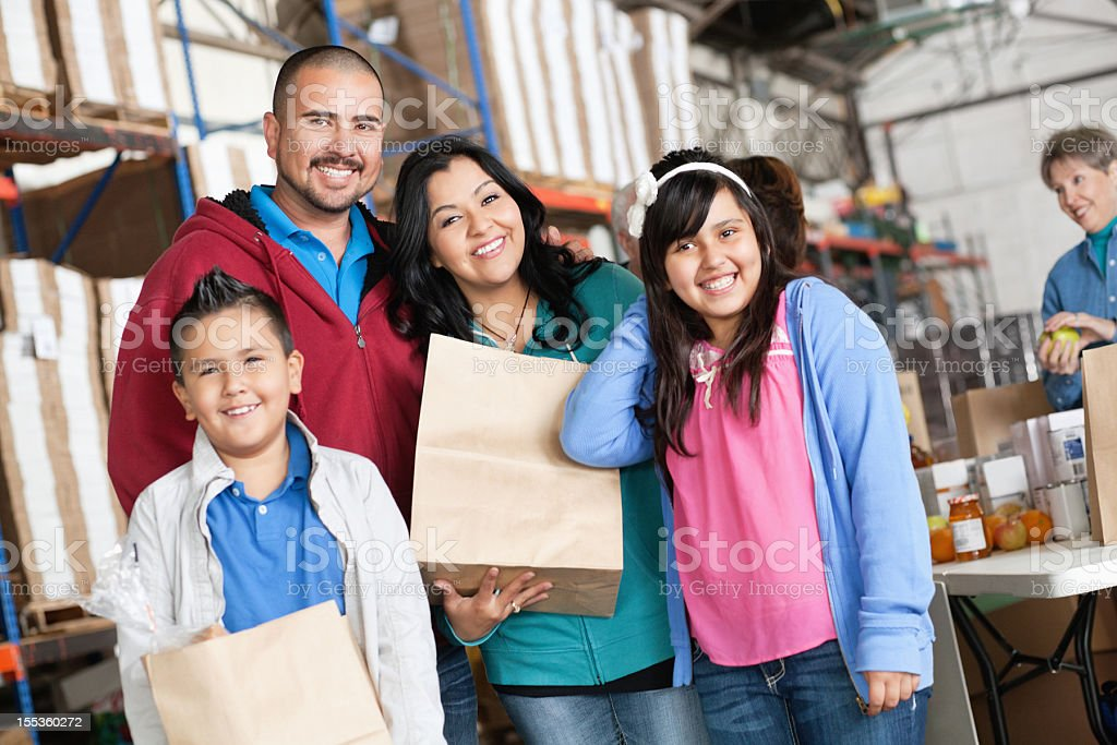 Family together at a donation center royalty-free stock photo