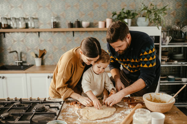 Family together at the kitchen counter stock photo