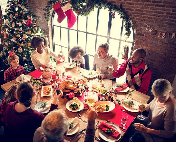 family together christmas celebration concept - dîner de famille photos et images de collection