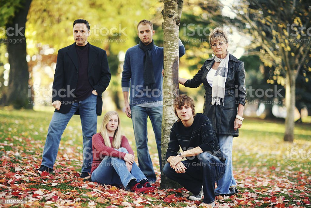 Family Together in Jeans among Red Autumn Leaves royalty-free stock photo