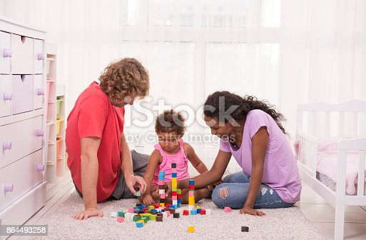 istock Family together playing at child room. 864493258