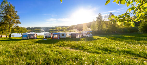 Family travel concept. Caravans and camping on the lake. Family travel concept. Caravans and camping on the lake. trailer park stock pictures, royalty-free photos & images