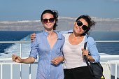 Family travel luxury cruise vacation, mother and teenage daughter enjoy sea trip on deck of liner on sunny summer day