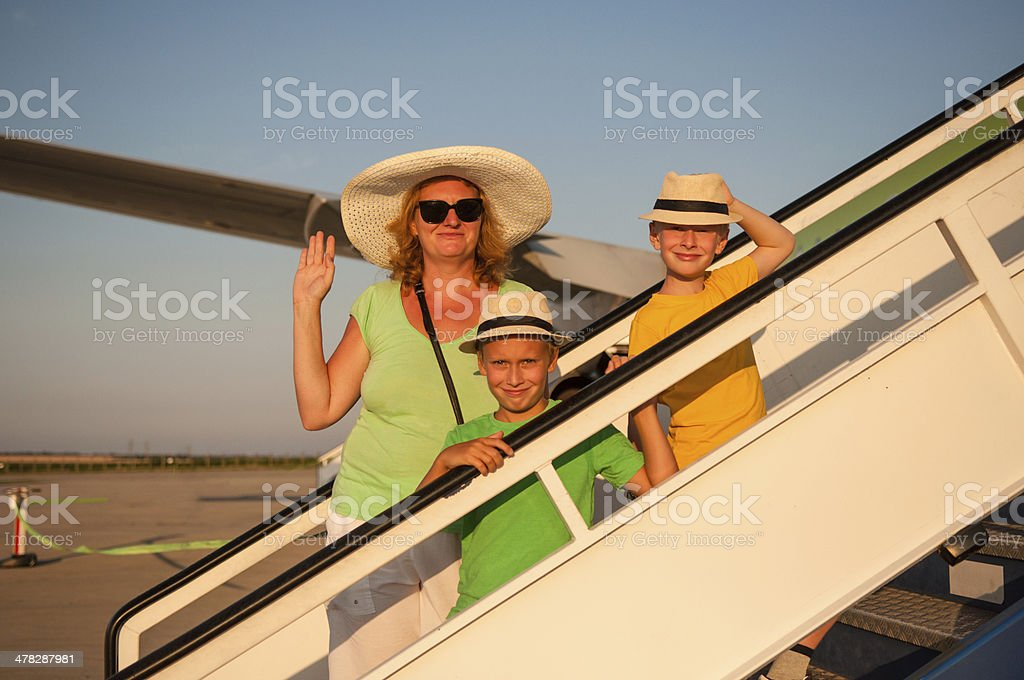 Family traveling by airplane royalty-free stock photo