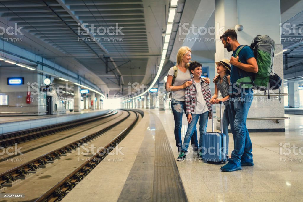 Family traveling by train together stock photo