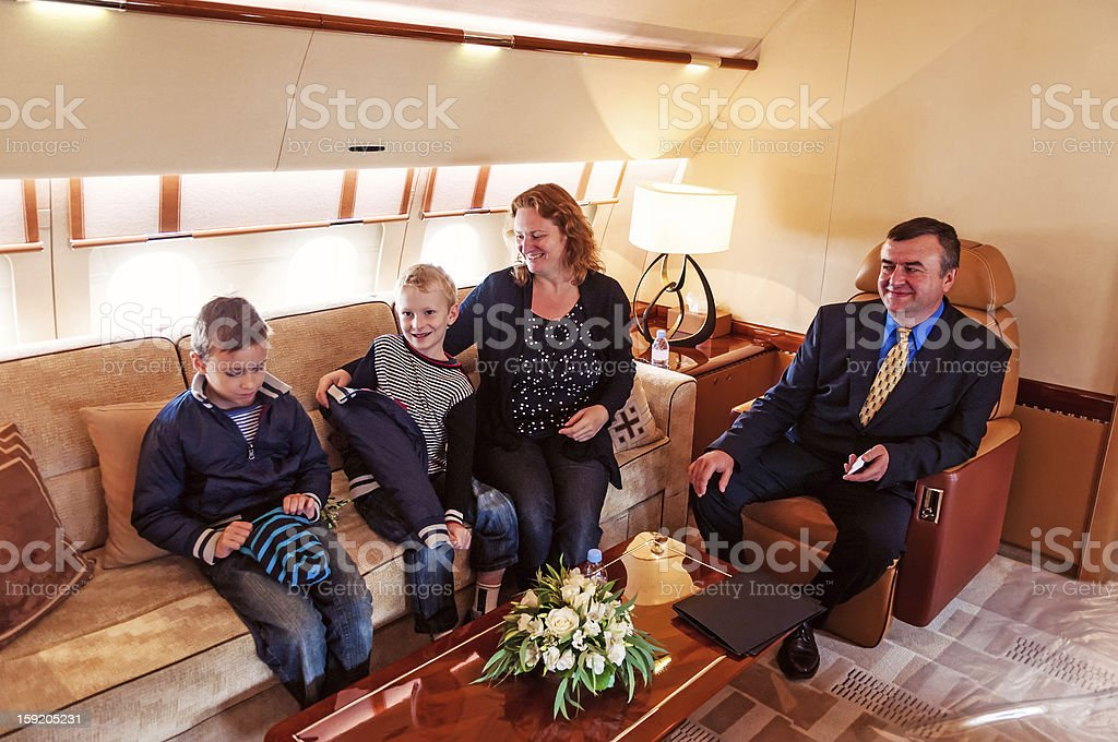 Family traveling on a private jet royalty-free stock photo
