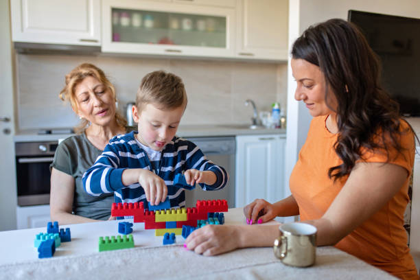family union fun - lego house stock photos and pictures