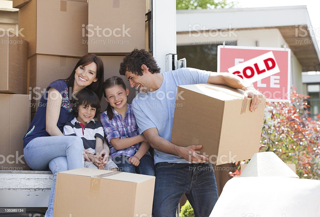 Family unloading boxes from moving van royalty-free stock photo