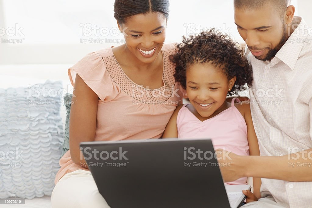 Family using a laptop at home royalty-free stock photo
