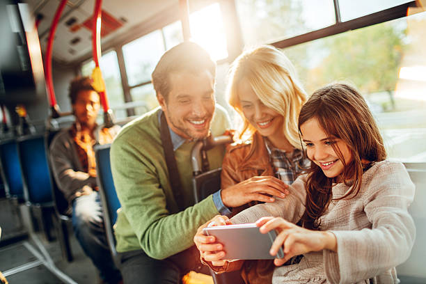 family using a phone - mobile game stock photos and pictures