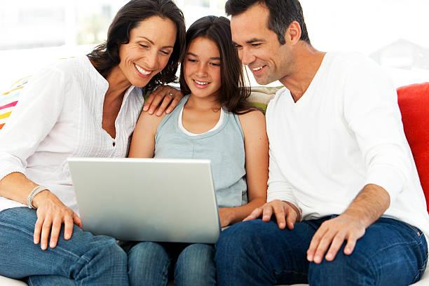 Family using computer stock photo