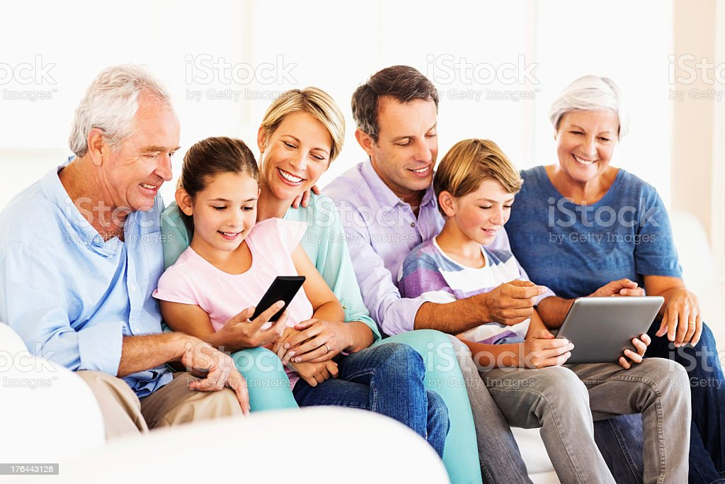 Family Using Digital Tablet And Smart Phone At Home royalty-free stock photo