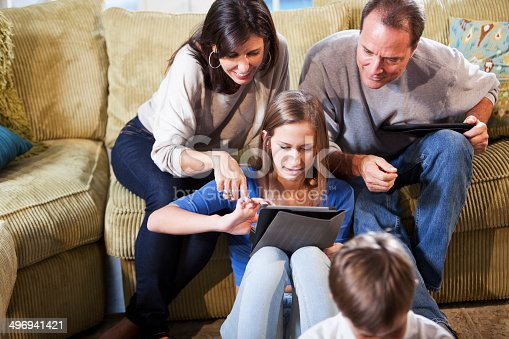 istock Family using digital tablet 496941421