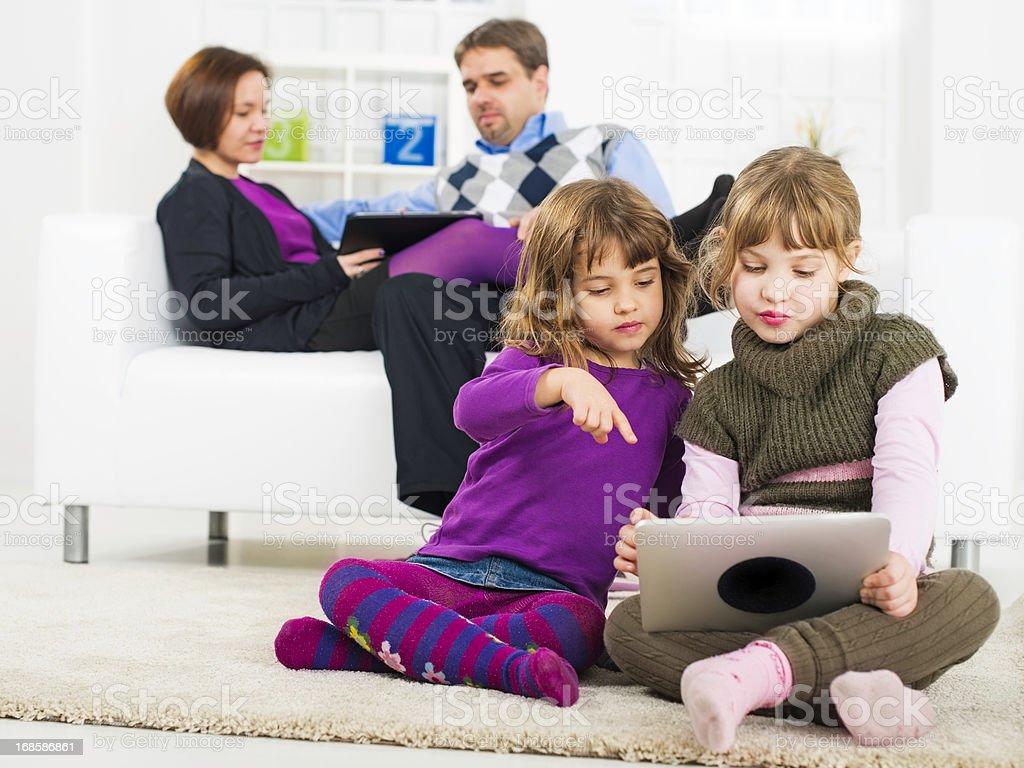 Family using digital tablets royalty-free stock photo