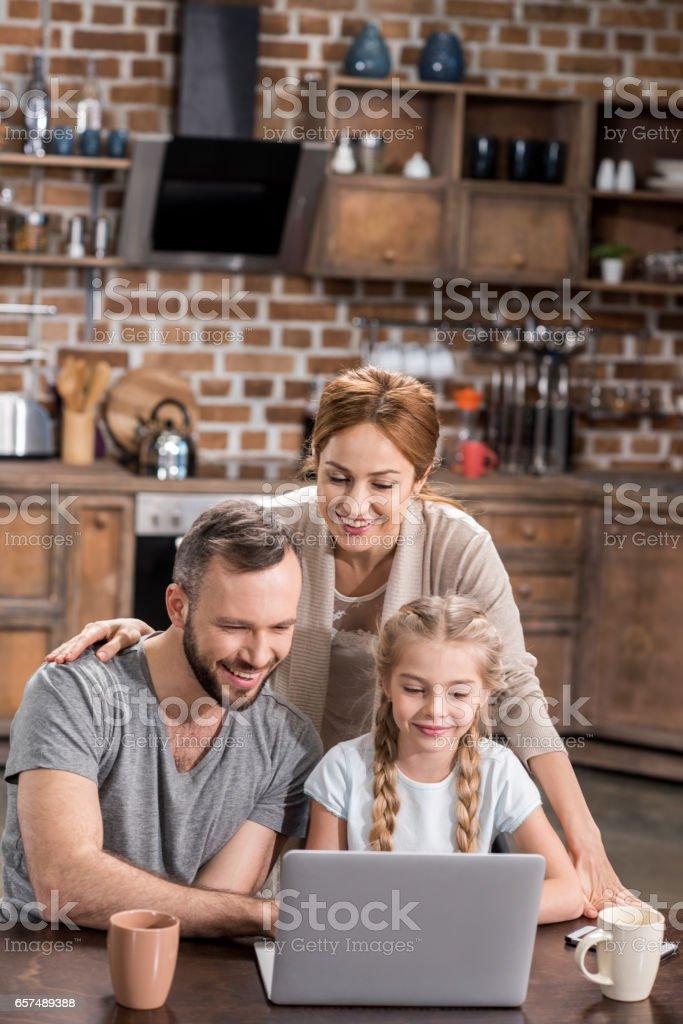 Family using laptop stock photo