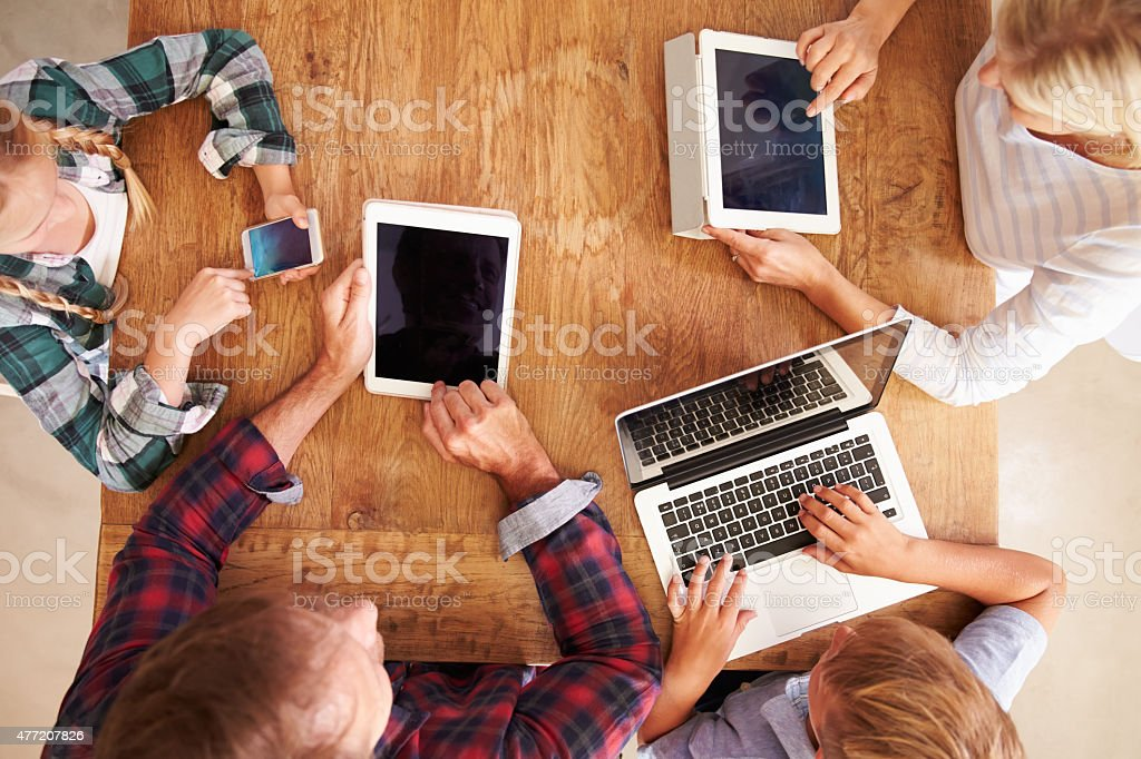 Family using new technology, overhead view stock photo