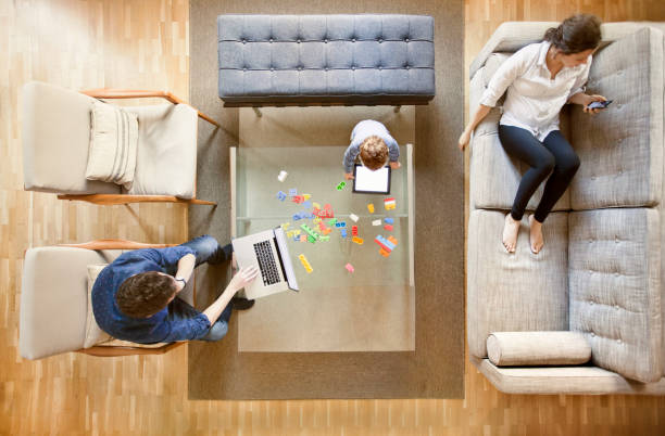 family using technology - family room stock photos and pictures