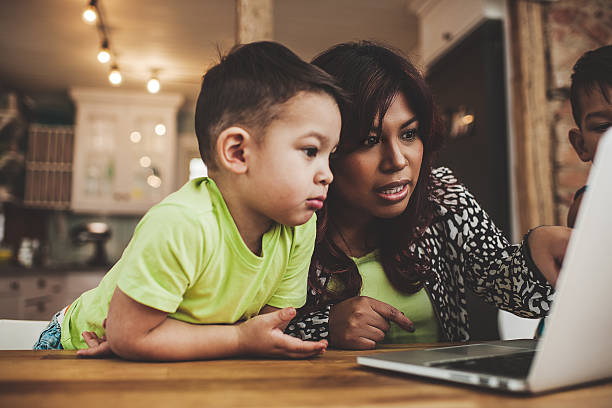 family using the computer laptop and surfing internet - peruvian ethnicity stock pictures, royalty-free photos & images