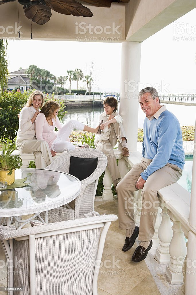 Family vacation, hanging out on terrace royalty-free stock photo
