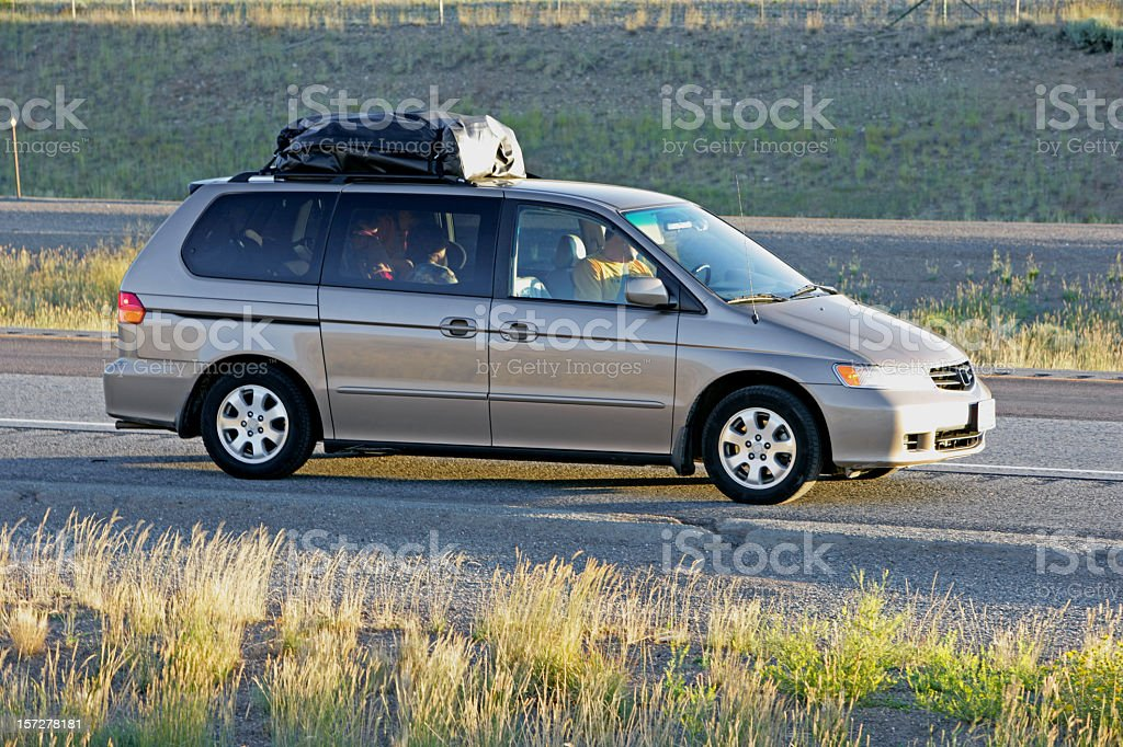 Family vacation in a gray minivan stock photo