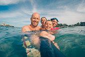 Family swimming in Huatulco Beach in Oaxaca State, Mexico.
