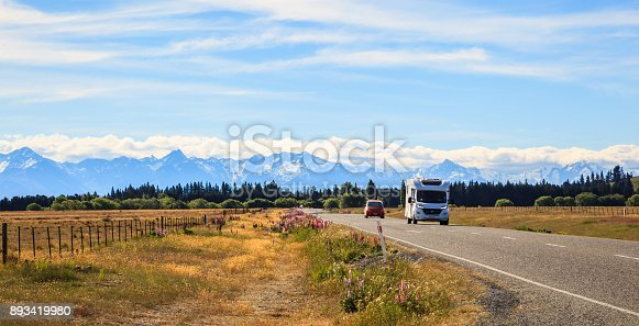930810564 istock photo Family vacation trip, leisurely travel in motor home, Happy Holiday Vacation in Caravan camping car. Beautiful Nature New Zealand natural landscape Scenic route with camper van in New Zealand. 893419980