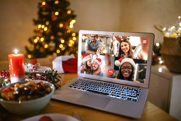 Family video chatting online on the occasion of Christmas celebration stock photo