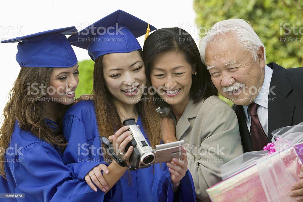 Family Videotaping Graduation stock photo
