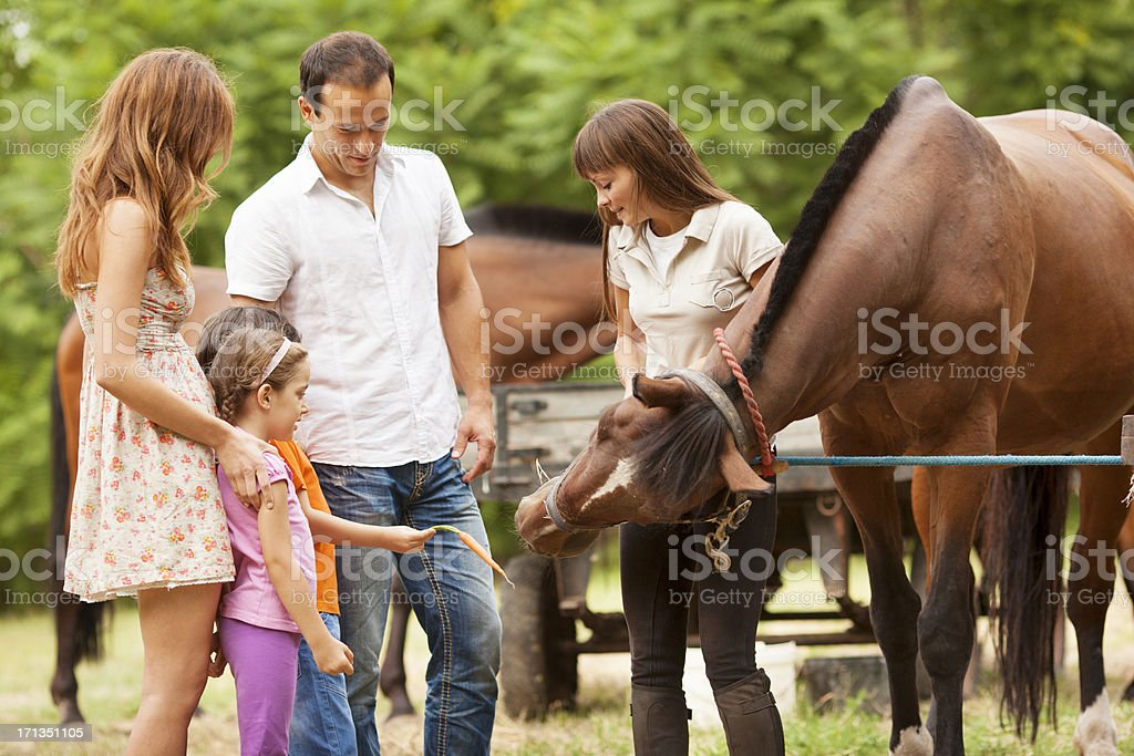 Family Visit Horse Riding School. stock photo